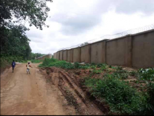 Part of the long perimeter fence of the DSS facility