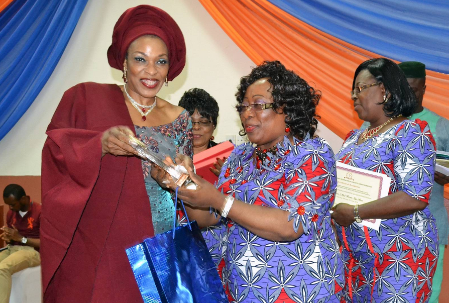 Mrs. Imoke receiving her award from the President of the Exquisite Ladies Foundation
