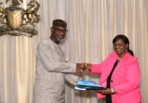 Cross River State Governor, Senator Liyel Imoke exchanging the 2014 Cross River/ UN Work Plan with country representative, Mrs. Ratidzai Ndhlovu shortly after the signing ceremony in Calabar