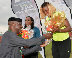 Cross River State Governor, Senator Liyel Imoke presenting a Gold medal/ bouquet of flower to Nigerian queen of the track, Blessing Okagbare, who won the women's 100mtrs heat finals with the time of 11.06 seconds at the ongoing Cross River/All Nigerian Athletics Championship, With her is the second finisher, Gloria Asumnu in Calabar today