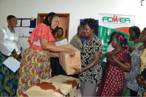 Mrs. Imoke presenting a gift to one of the widows