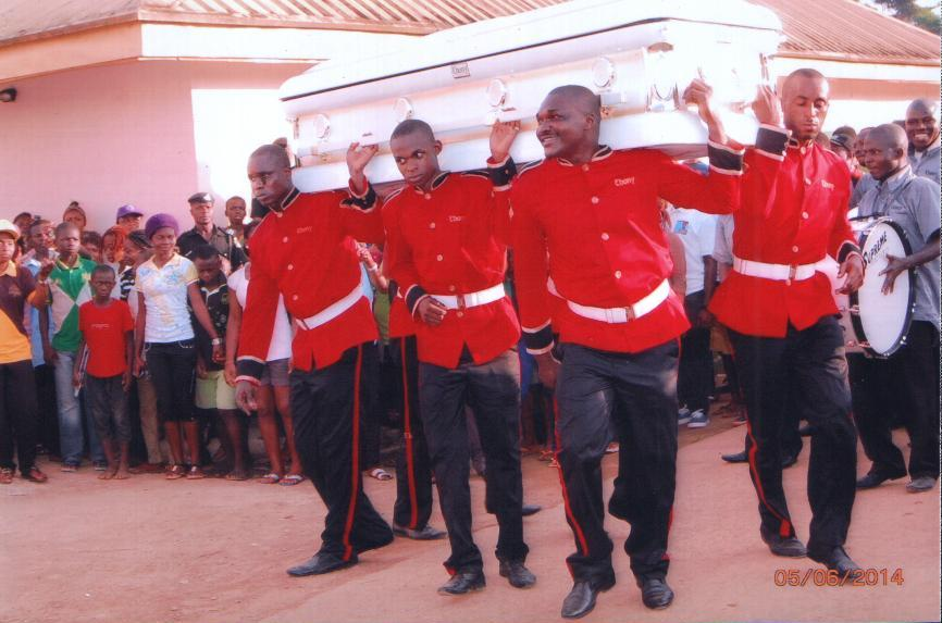 Pall bearers carrying the remains of Sir Louis Owan Enoh