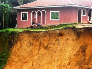 Dr. Ogban's neighbours house that was cut Off from the road network
