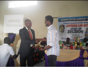 Dr. Ejue Bassey, Rector COE Akamkpa receiving an award during the event
