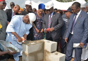 PDP National Chairman,  Alhaji Adamu Mu'azu laying foundation for the construction of 200 housing units of the Golf Estate at the Summit Hills , Calabar while Cross River State Governor, Senator Liyel Imoke and wife Obioma (behind), MD UACN Property Development Company (UPDC), Mr. Hakeem Ogunniran (R) and others look on