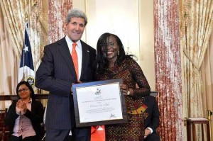 Beatrice Jedy-Agba, Executive Secretary of Nigeria's National Agency for the Prohibition of Trafficking in Persons [NAPTIP] receiving the award from America's Secretary of State, John Kerry in the Benjamin Franklin Room of the US State Department