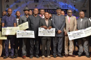 Cross River State Governor Sen Liyel Imoke (3rd right) flanked by his deputy Mr Efiok Cobham, SA investment Promotion, Mr. Gerald Adah and a cross section of beneficiaries of the federal government assisted N1 billion facility for MSMEs during Youth in Enterprise showcase 2014 in Calabar