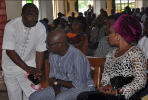 Hon. Steve Ukpekpen (left), Governor Imoke and his wife, Obioma Imoke during the funeral service