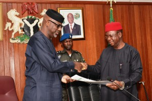 Governor Imoke of Cross River (left) and Governor Martin Elechi of Ebonyi exchanging documents after the meeting in Abakaliki