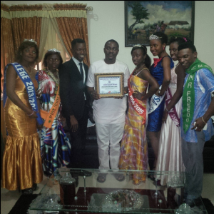 Mr. Jessy Ejemot (middle) surrounded by excos of the National Association of Beauty Queens & Kings during the presentation of the award of Patron to Mr. Ejemot in Calabar