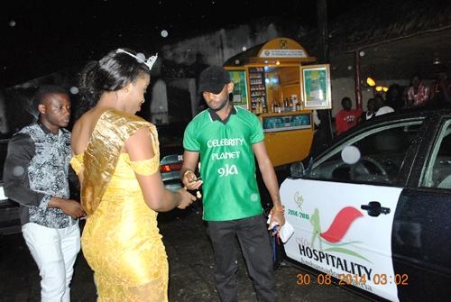 Executive Director of Celebrities Planet, Raymond Ago handing over the Toyota Camry 2009 keys to the winner of Miss Hospitality Ambassador Nigeria