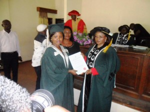 One of the inductees receiving her certificate
