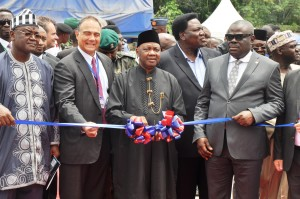 Vice President Arch. Namadi Sambo flanked by the Deputy Governor of Cross River, Mr. Efiok Cobham, Minister of Culture and Tourism High Chief Edem Duke (R) and  Chairman Unicem Board of Directors, Mr. John  Coumantaros, Minister of State for Trade and Investment, Dr. Samuel Ortom in a symbolic cutting of tape during the ground breaking ceremony for the construction of additional 2.5 million metric tons production line of United Cement Company, in Mfamosing, Cross River today