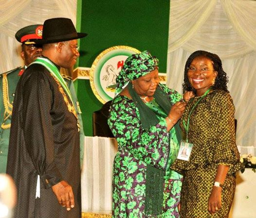 Mrs. Beatrice Jedy Agba being decorated by the Chief Justice of the Federation, Justice Aloma Muktar