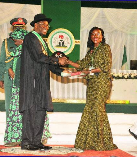 Mrs. Beatrice Jedy Agba receiving the national award from President Jonathan today in Abuja