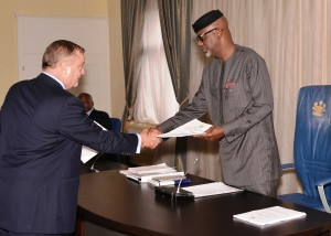 Governor Imoke exchanging signed copies of the agreements with one of the concessionaires
