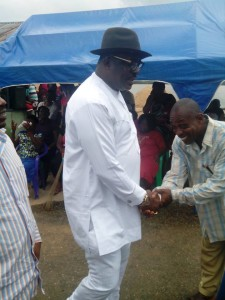 Hilliard Eta, National Vice Chairman, South South, APC greeting a member during the cross river ceremony in Calabar recently