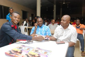 Obaji Akpet of CrossRiverWatch (left) presenting the anniversary copy of CrossRiverWatch to the Executive Chairman, Obudu LGA, Hon. Emma Ugbe, (center) and Hon. Steven Ukpukpen, Member representing Obudu in the CRSHA