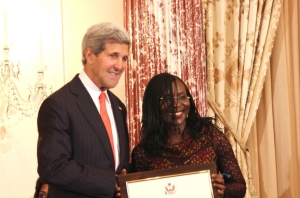 US Secretary of State, John Kerry (left) presenting the award to Mrs. Jedy Agba earlier in the year at the US State Department, Washington