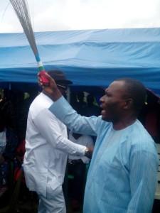 Pastor Usani Uguru Usani, Cross River State Chairman, APC brandishing the broom during the ceremony