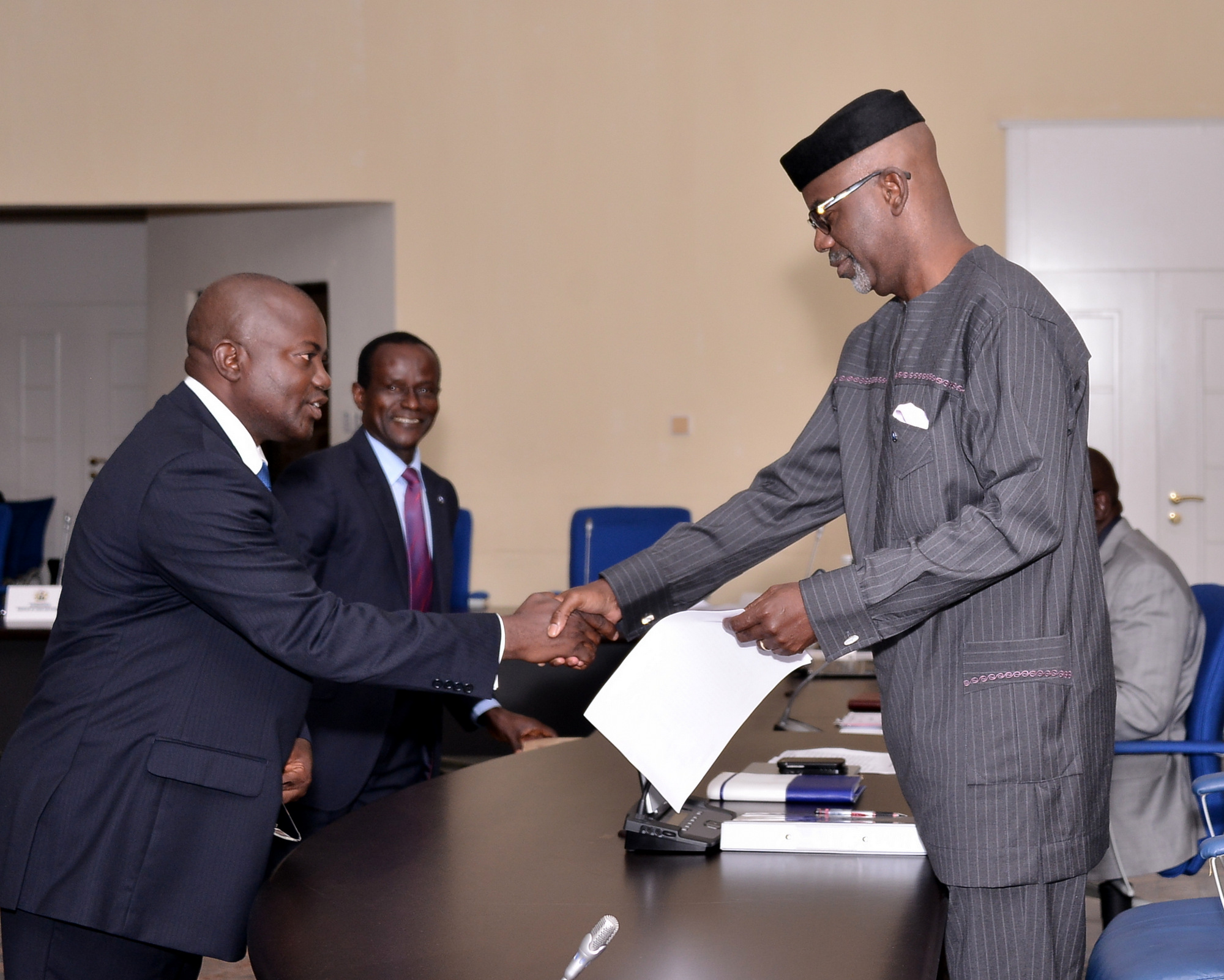 Cross River State Governor Senator Liyel Imoke congratulating the newly sworn-in Secretary to the State Government (SSG) Dr. Tom Ogar, shortly after taking oath of denunciation of cultism and that of office in Calabar, yesterday