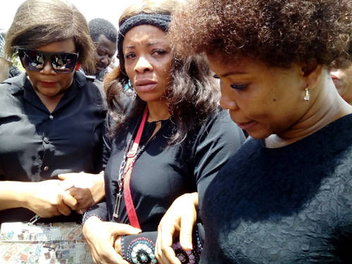 Middle, bereaved AGN Chair, Monica Udofia; being consoled by Actress, Eunice Etim and AGN Secretary, Susan Samuel (L-R)