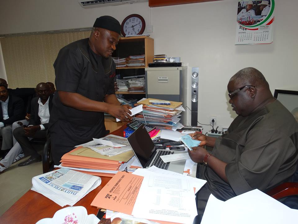 Legor Idagbo presenting his bank draft for the purchase of Cross River PDP governorship nomination form at Wadata House Abuja, yesterday