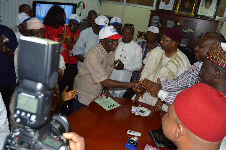 Senate Leader, Victor Ndoma Egba, SAN greeting PDP secretariat staff and the National Organizing Secretary of the party when the Senator went to pick his nomination form to return in 2015