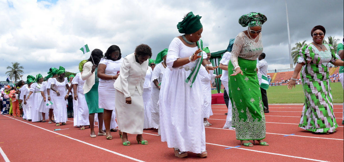 (M) wife of the cross river state governor, Mrs Obioma Liyel Imoke(M) flanked by wife of the Deputy Governor Mrs Glory Cobham(R) and that of the Speaker CRHA, Mrs. Eneyi Larry Odey(L), leading other women in the state in a dance past to celebrate Nigeria's 54th Independence anniversary in Calabar this morning