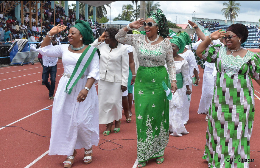 Wife of the Cross River State Governor, Mrs. Obioma Liyel Imoke (M) Deputy Governor's wife, Mrs Gloria Cobham(R) and wife of the Speaker of the State House of Assembly Mrs. Eneyi Larry Odey, giving the crowd a salute during the celebration of the nation's 54th Independence Anniversary in Calabar this morning