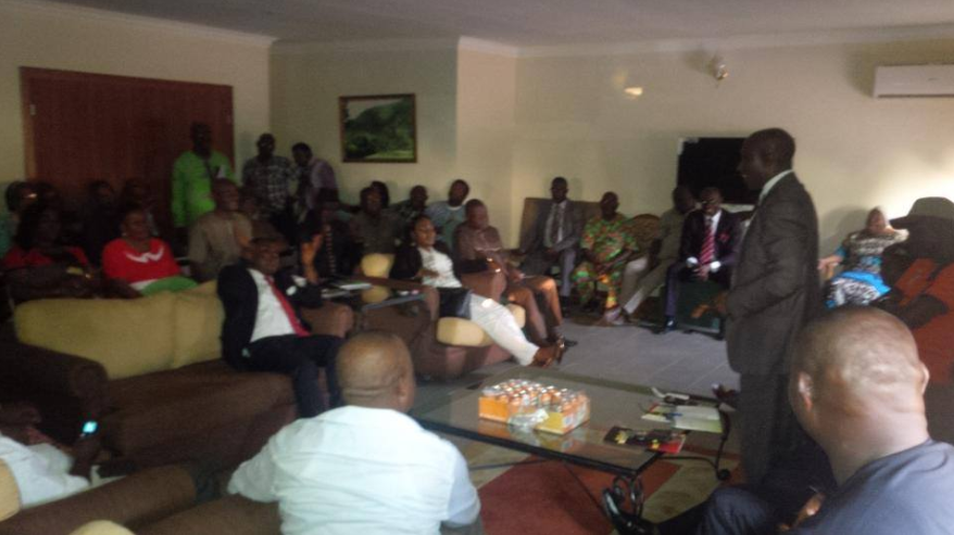 Senator Ayade (sitting) and his PA, Dr Odey (standing) having a chat with supporters