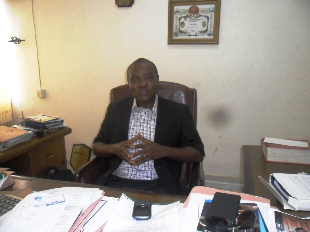 Mr. Vincent Aqua talking to CrossRiverWatch in his Calabar office