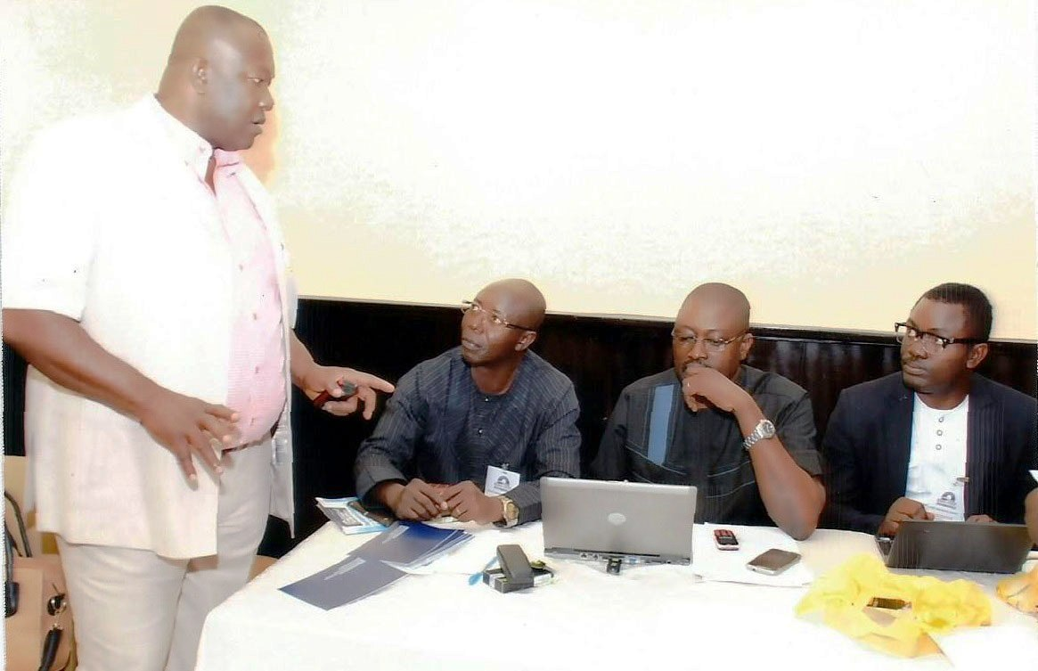 Mr. Effiong Nyong (standing) talking other exco members of CCRP after a program by the group in Calabar recently