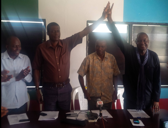 APC governorship candidate, Odey Ochicha lifting the hand of his deputy while the party chairman in the state Usani Usani and Mr. Cletus Obun watch