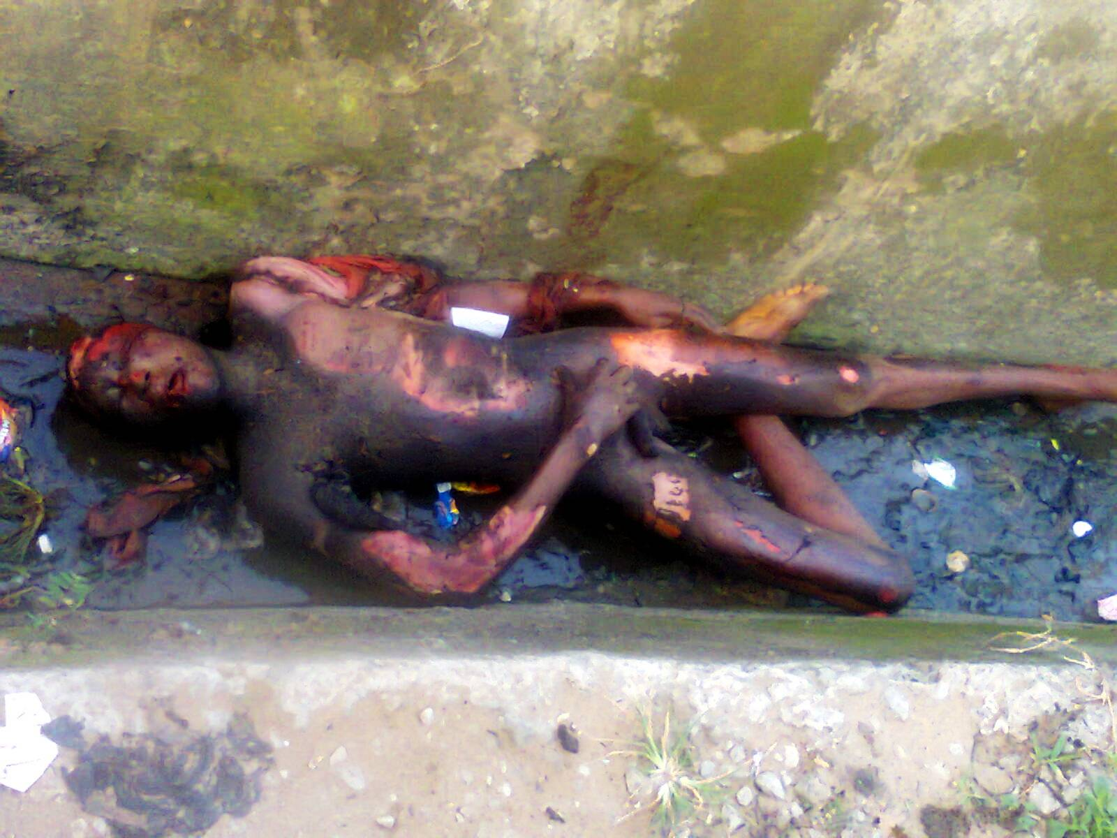 The unidentified suspected robber burnt by residents in Calabar recently