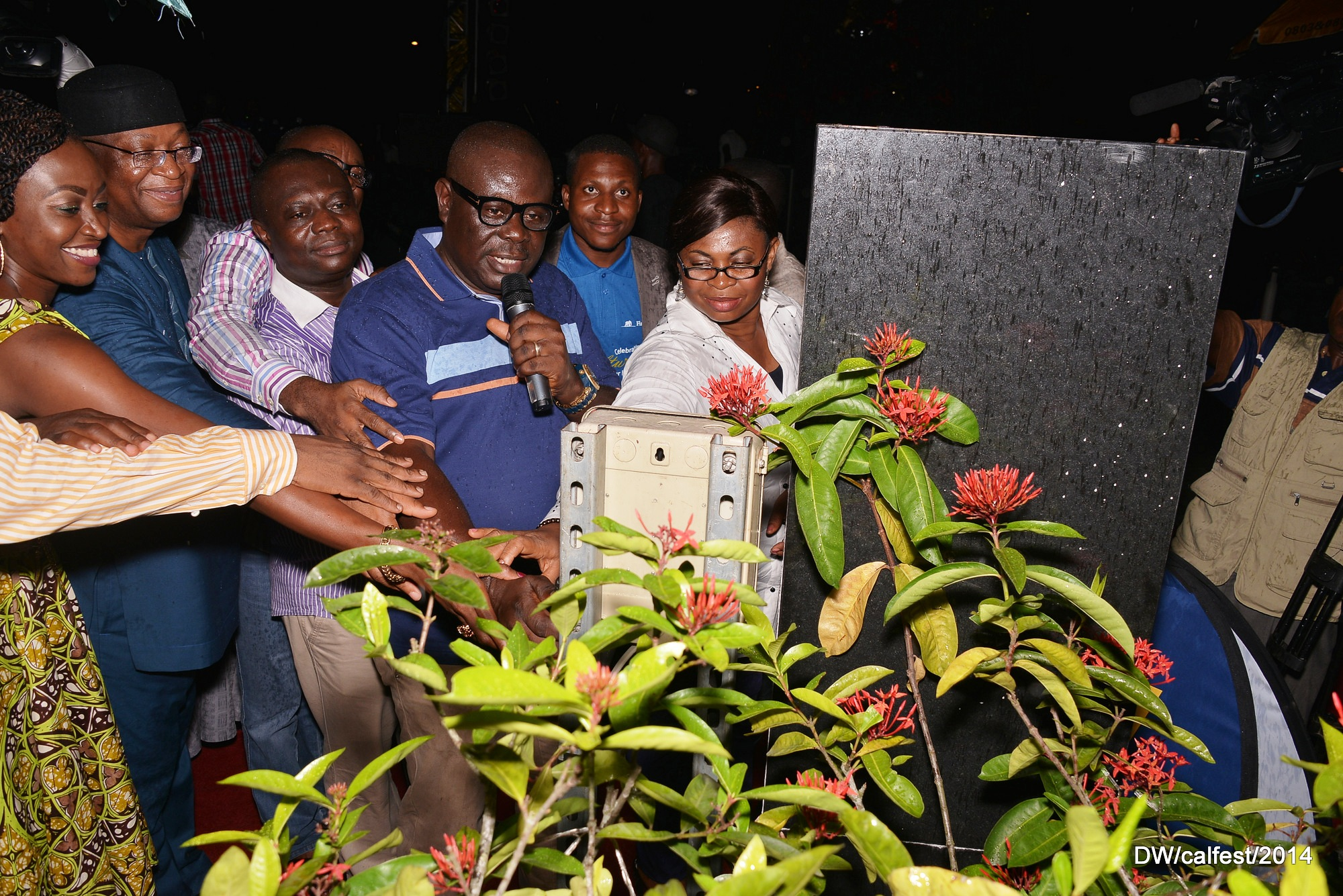 Cross River State Deputy Governor Mr. Efiok Cobham supported by other dignitaries to switch on the symbolic Calabar Festival Christmas tree,to kick start the annual 32 days event in Calabar,Sunday