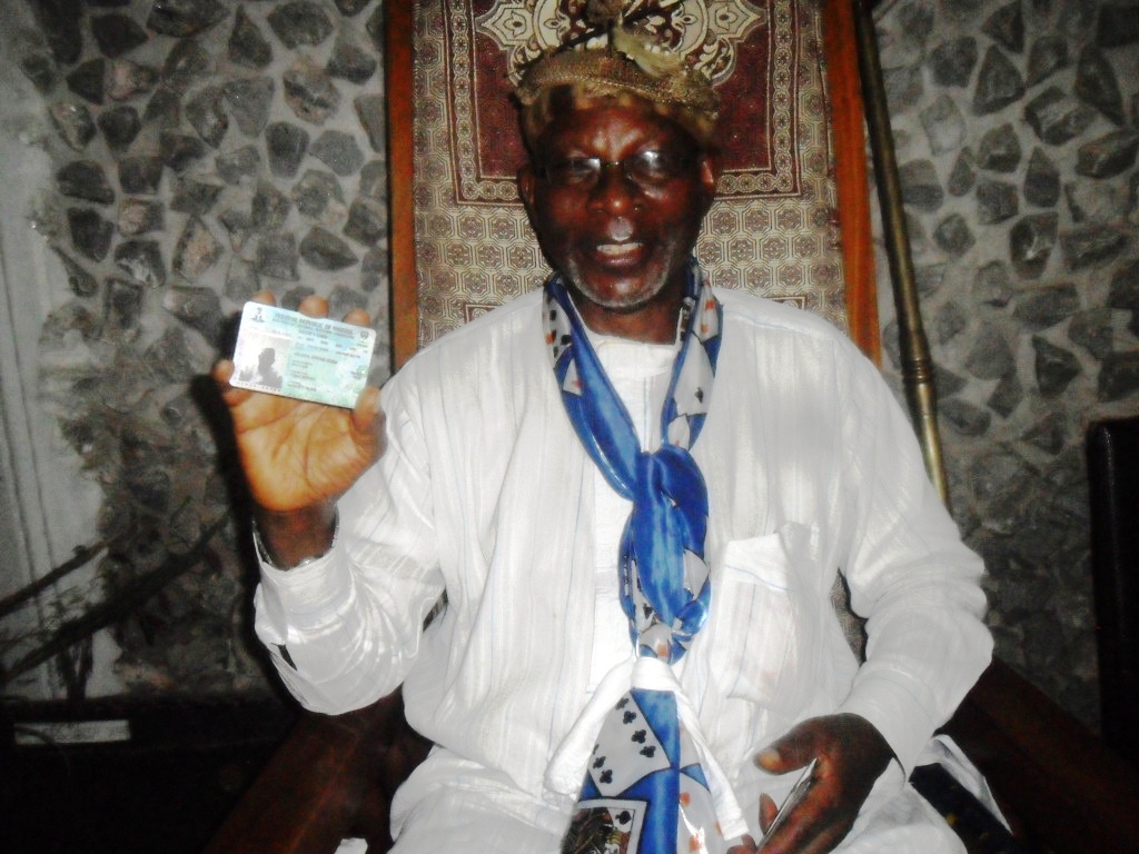 Muri Munene displaying his voters card