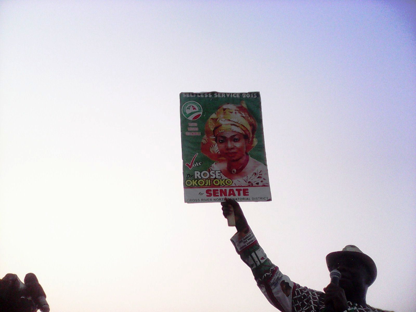 Ntufam John Okon holding the poster of Honourable Rose Oko at the campaign in Ogoja