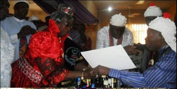 High Chief (Mrs.) Minika Etim James receiving her certificate of office as Obonganwan of Henshaw Town