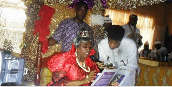 High Chief (Mrs.) Minika Etim James, Obonganwan of Henshaw Town giving her acceptance and thank you speech with assistance from her grandson