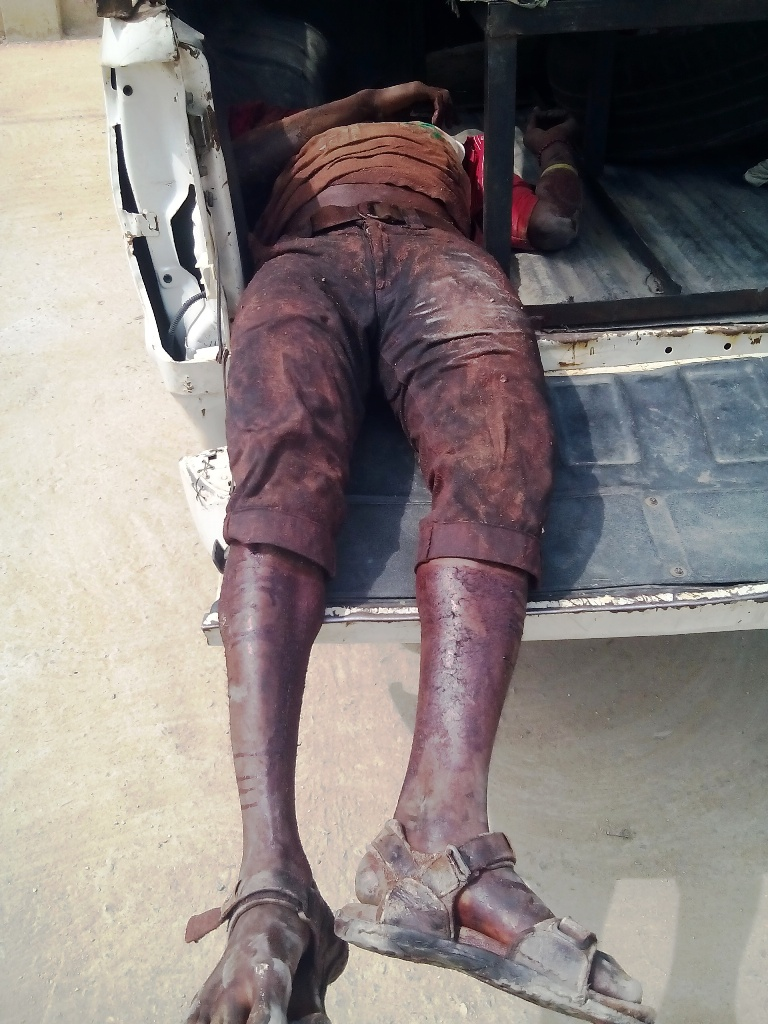 Michael, Okon's colleague lying dead in the police van