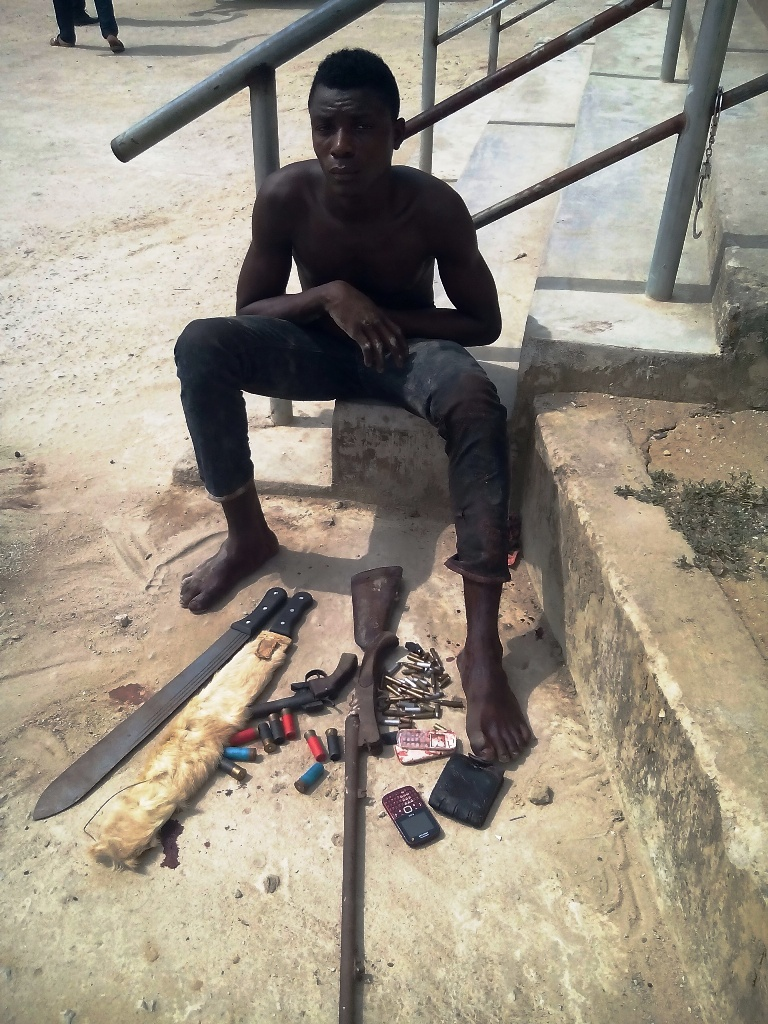 The alleged robber Okon Effiong Okon with their weapons