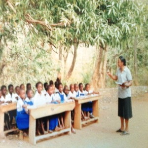 More pupils receiving lectures under a tree