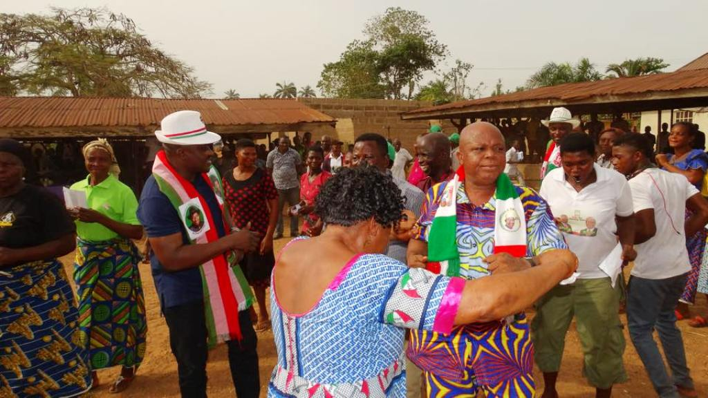former Buhari coordinator in Cross River, Engineer Oko dancing with the PDP Reps candidate during the decamping ceremony
