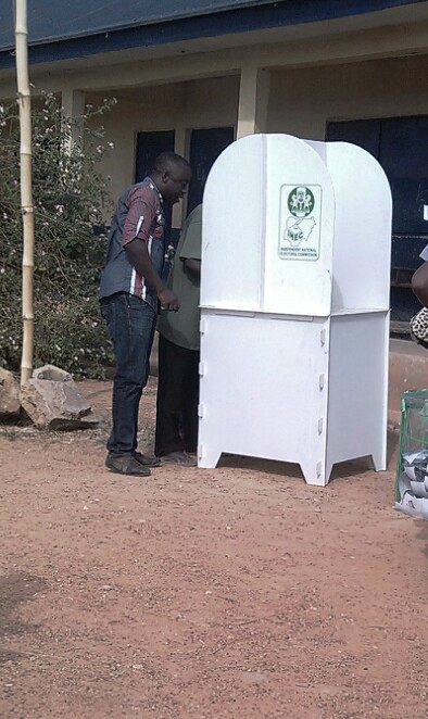 A PDP agent canvassing for votes in the voting cubicle yesterday