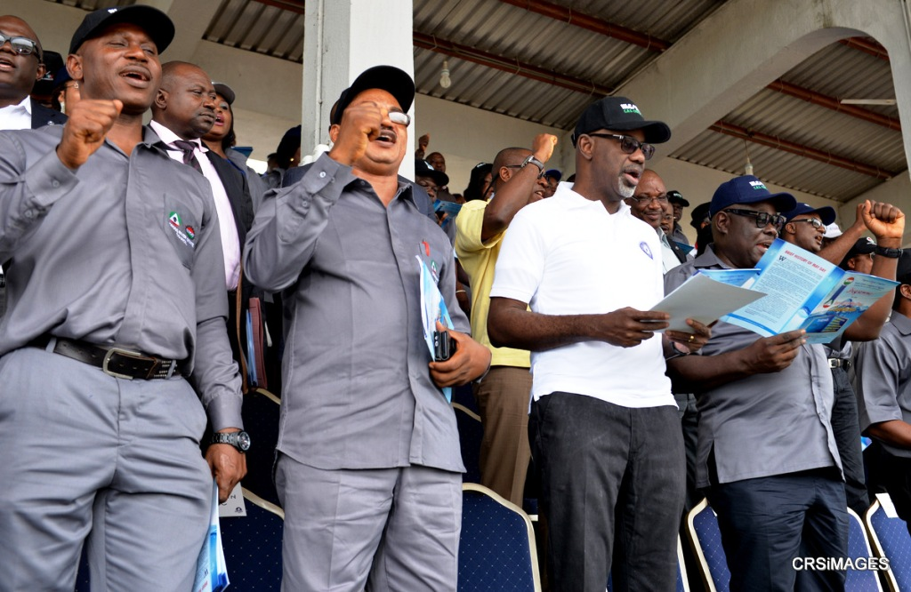 (2nd right) Cross River State Governor Senator Liyel Imoke, flanked (right) by his Deputy, Barr. Efiok Cobham, (left) State Chairman, Nigerian Labor Congress (NLC) Comrade John Ushie and the state Trade Union Congress (TUC) Chairman, Comrade Clarkson Otu during the rendition of the Union's solidarity song, to commemorate this year's workers day celebration in the state