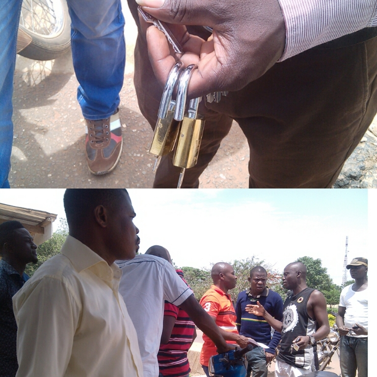 Task force leader holding padlocks and sympathisers