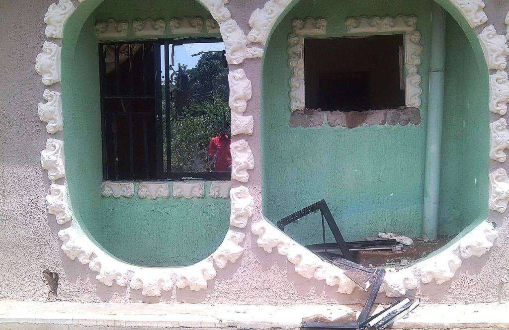 The smashed window through which the kidnappers gained access