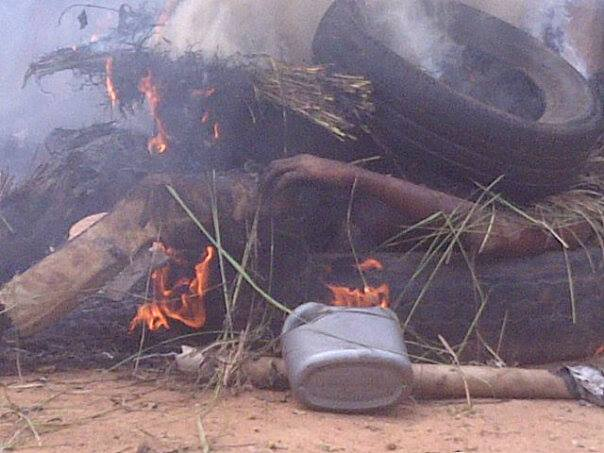 One of the suspected robbers in flames