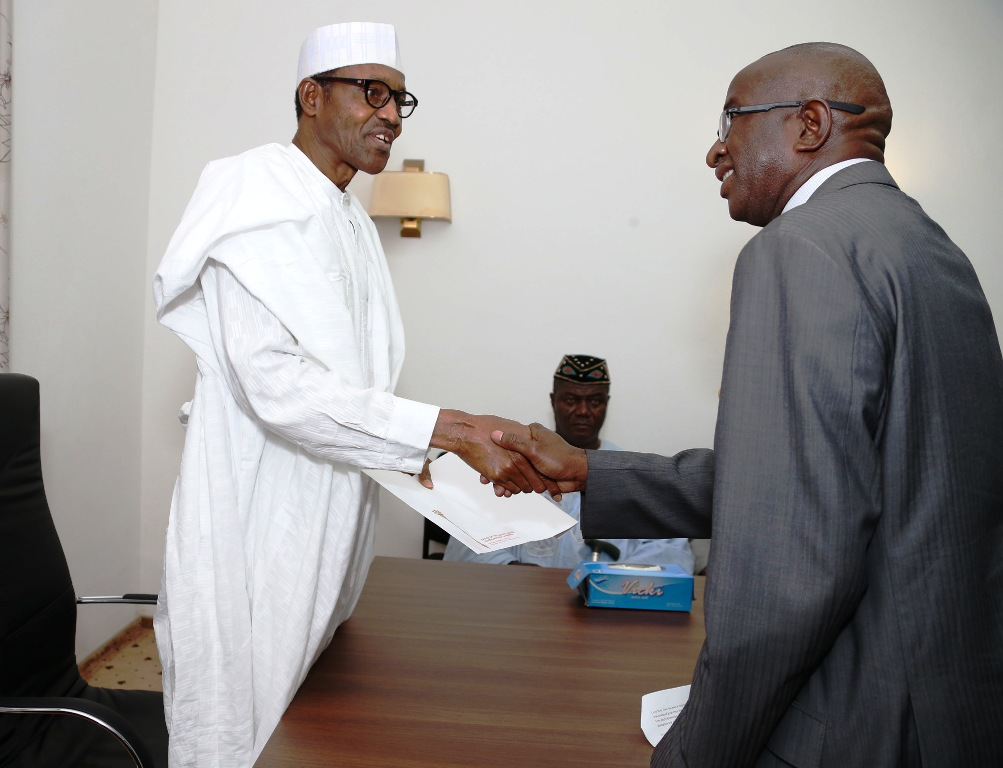 Senate Leader, Ndoma Egba in a handshake with the President Elect during the visit